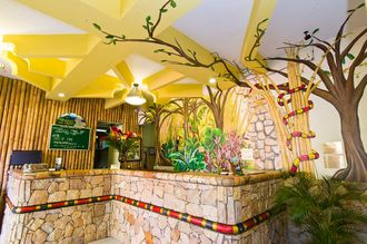 Adventure Inn front desk >> hotel