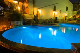 Our solar-heated pool and Jacuzzi at night